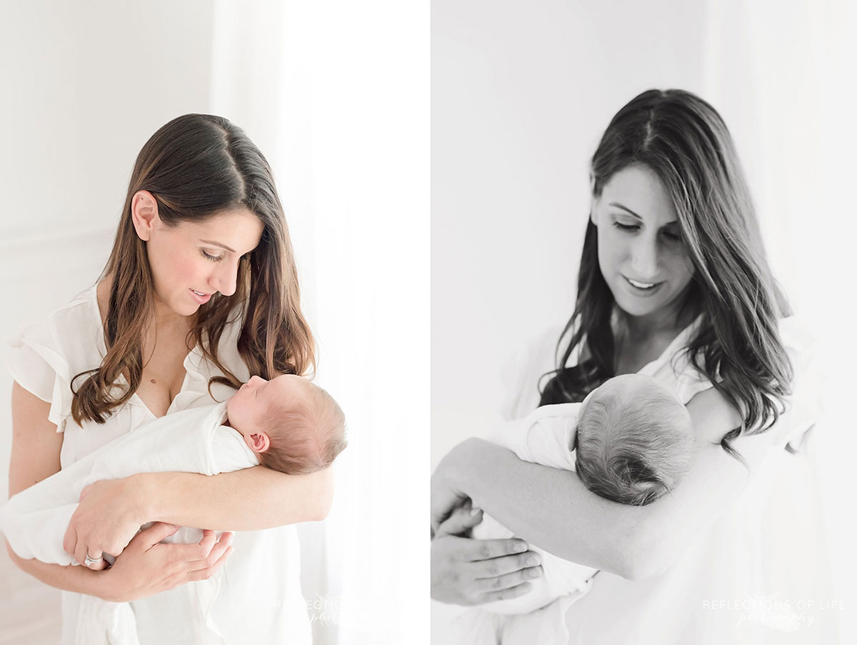 Mother holding baby in white studio