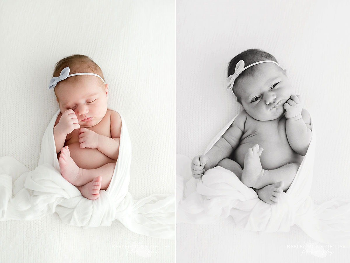 Baby girl with bow in hair wrapped in white