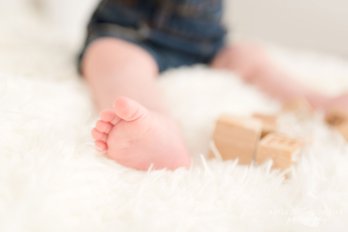 Baby toes by wooden blocks in Grimsby Ontario