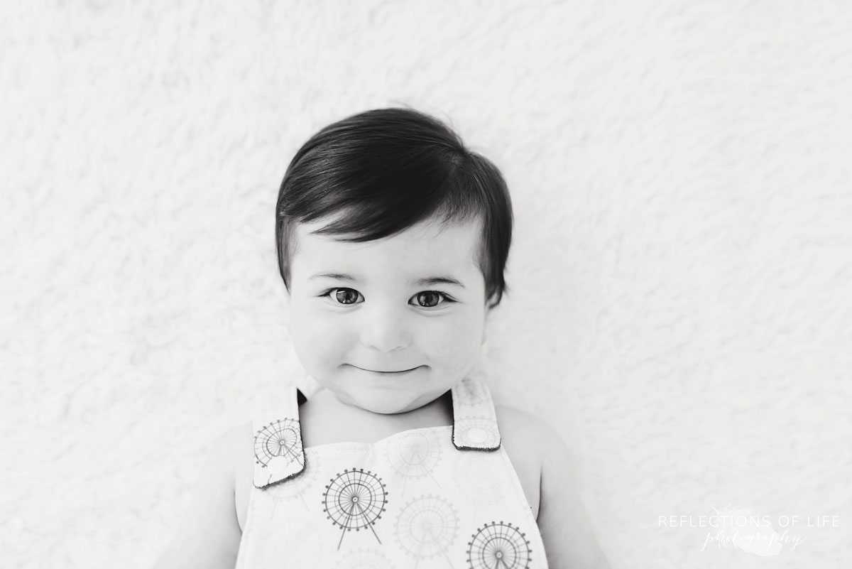 Black and white of baby smiling at camera