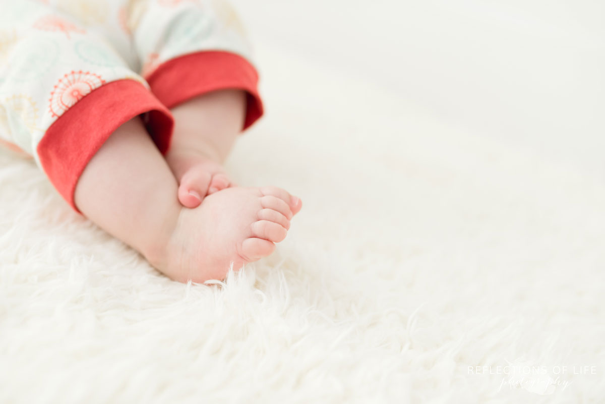Baby toes on white blanket