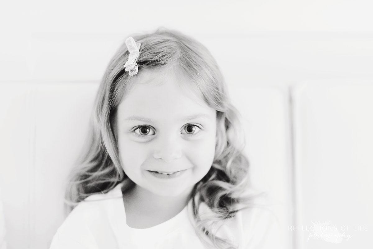 young girl looking at camera and smiling