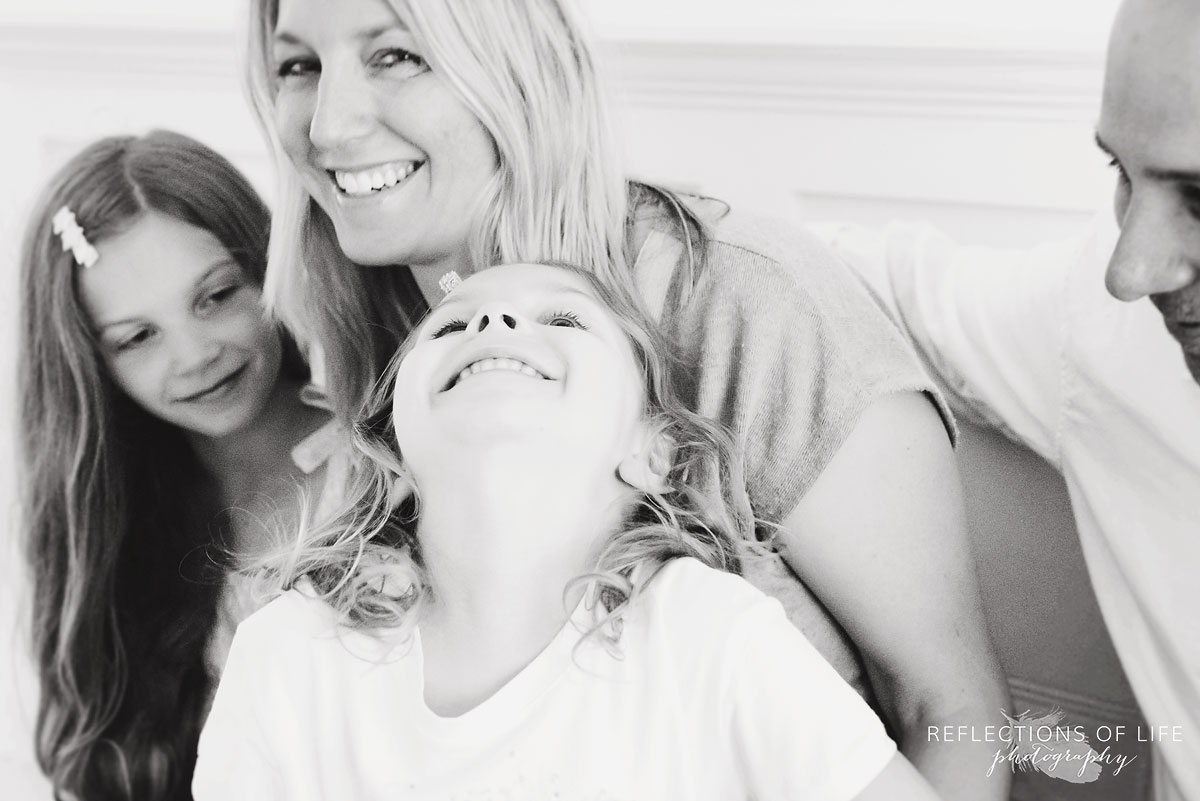 family laughing together in studio