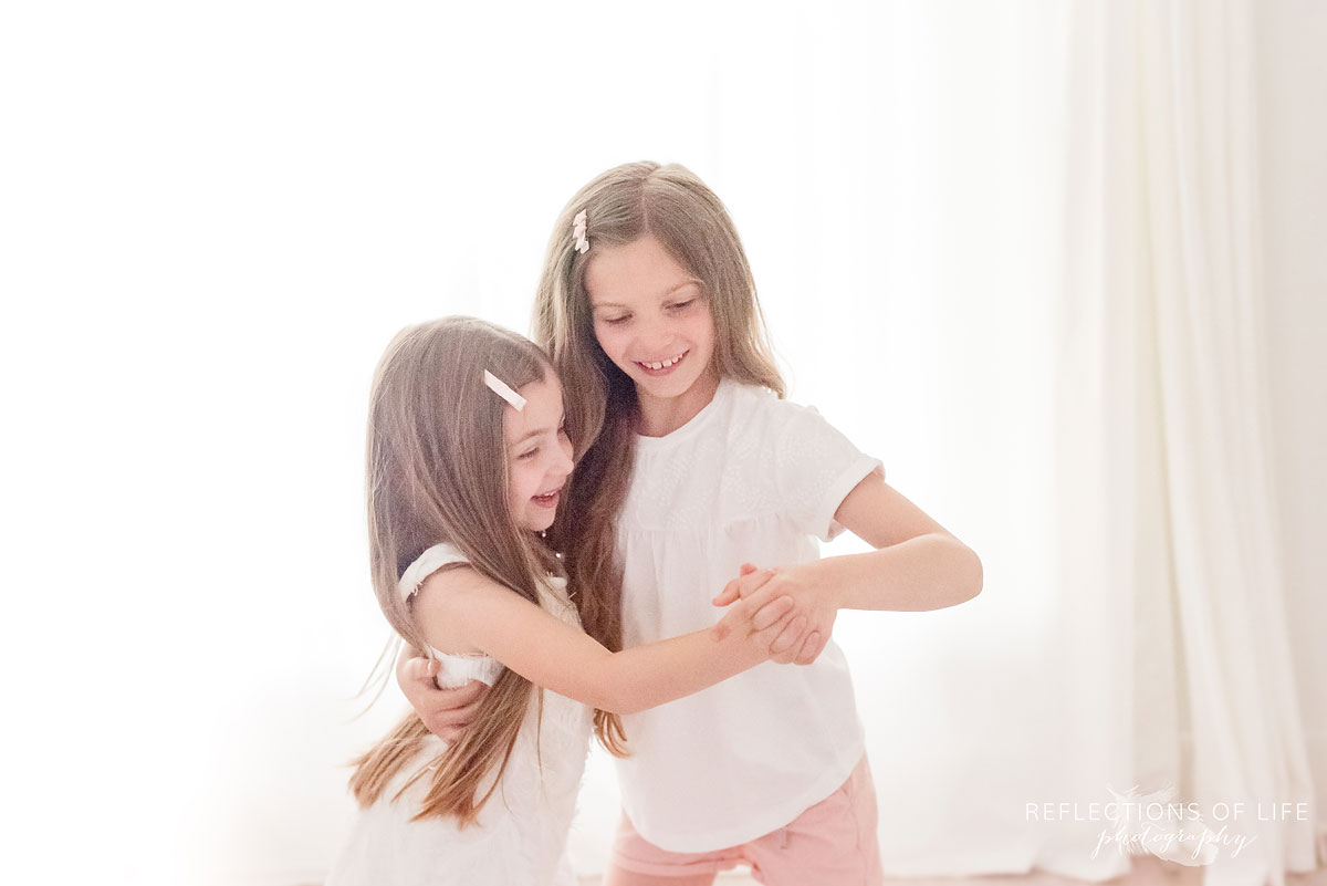 two girls dancing together in studio