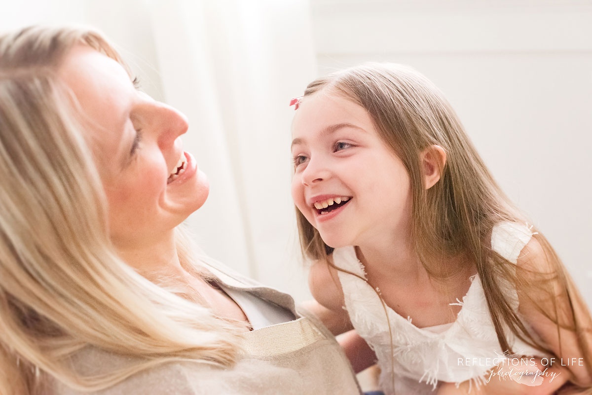 mom and daughter laughing together