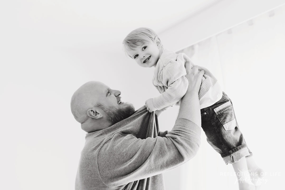 black and white dad and son playing in studio