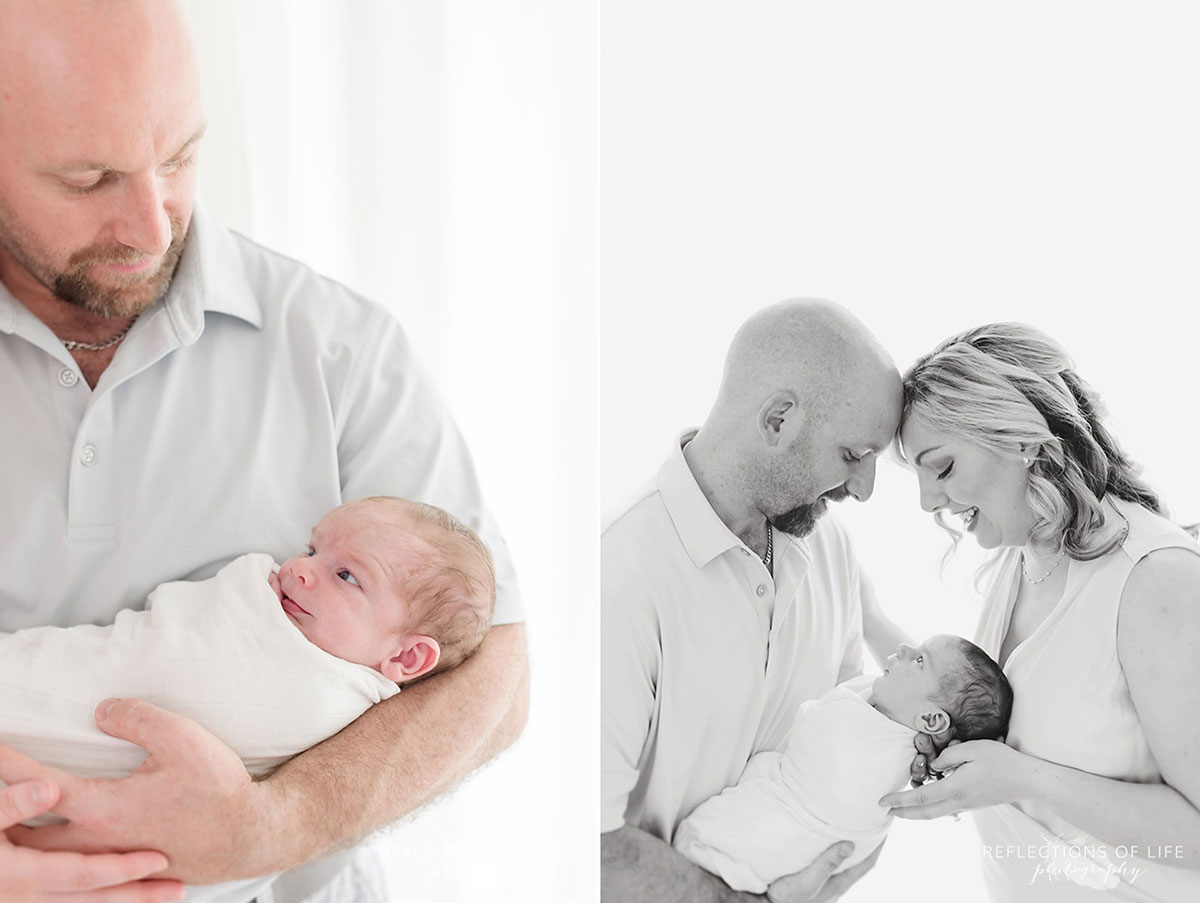 parents holding newborn son wrapped in blanket