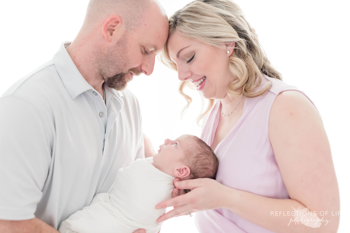 family in studio parents and baby