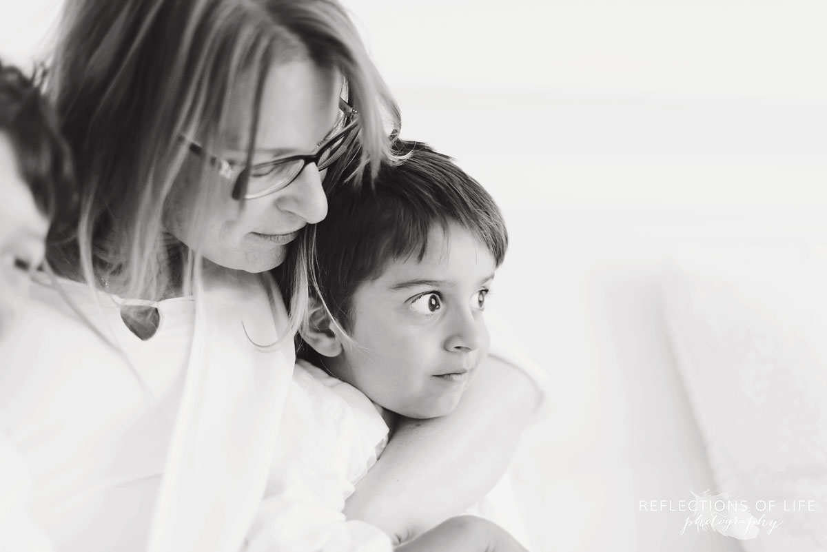 mother and son portrait in studio black and white