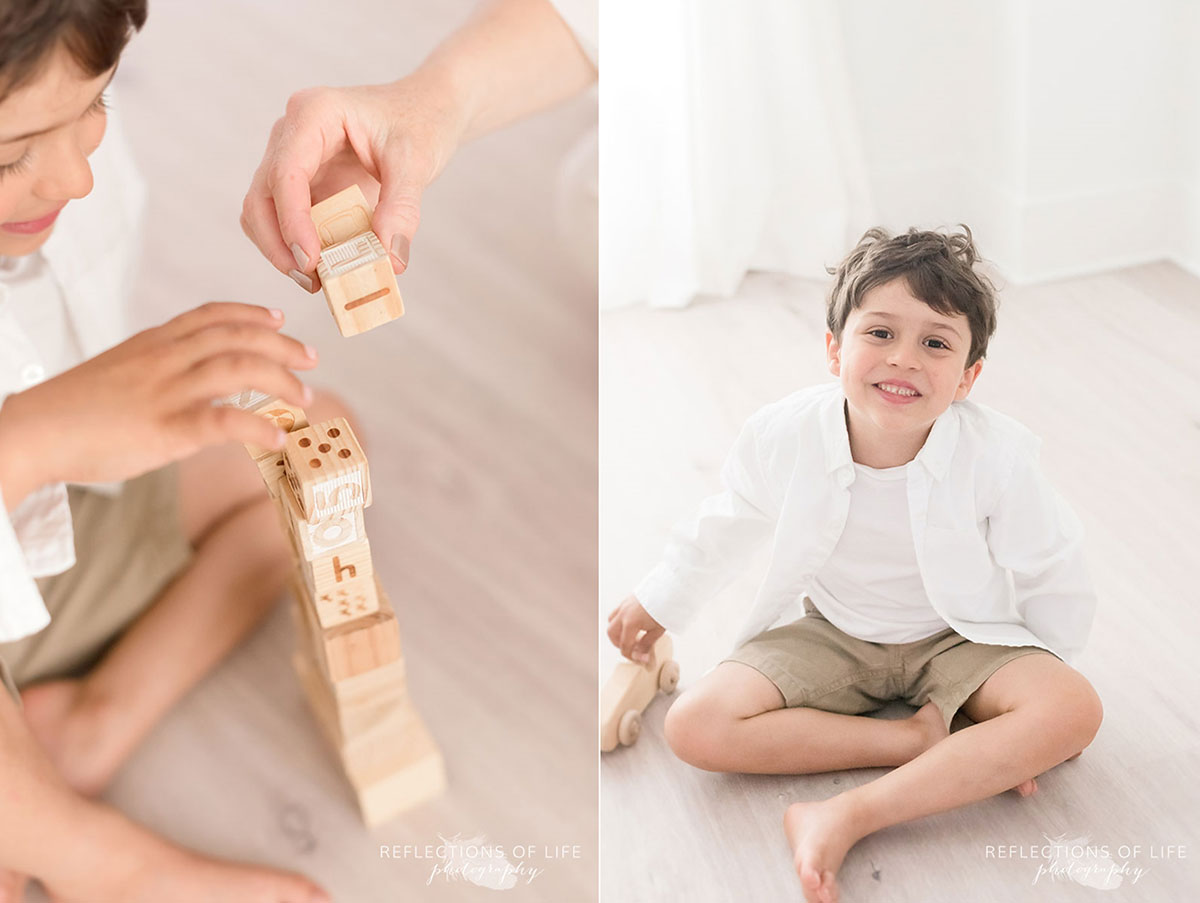 young boy in studio playing with blocks