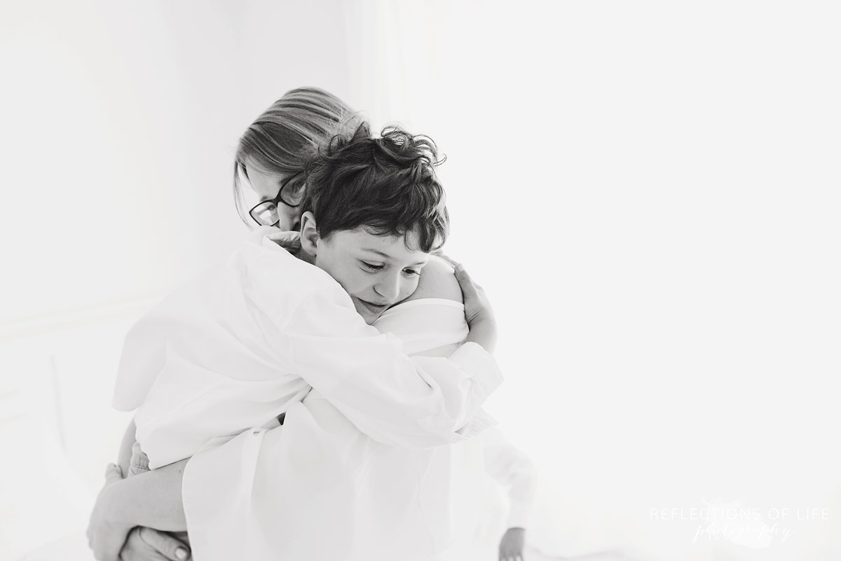 mom and son hugging black and white