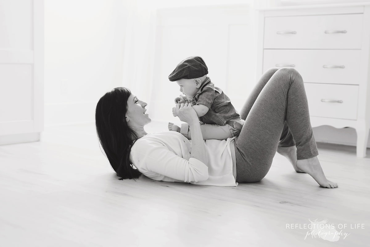baby sitting with mom on studio floor black and white.jpg