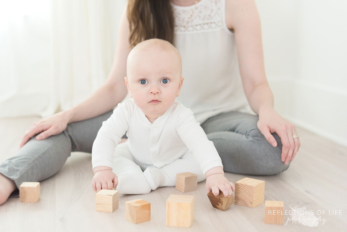 mother and baby sitting in studio with blocks.jpg