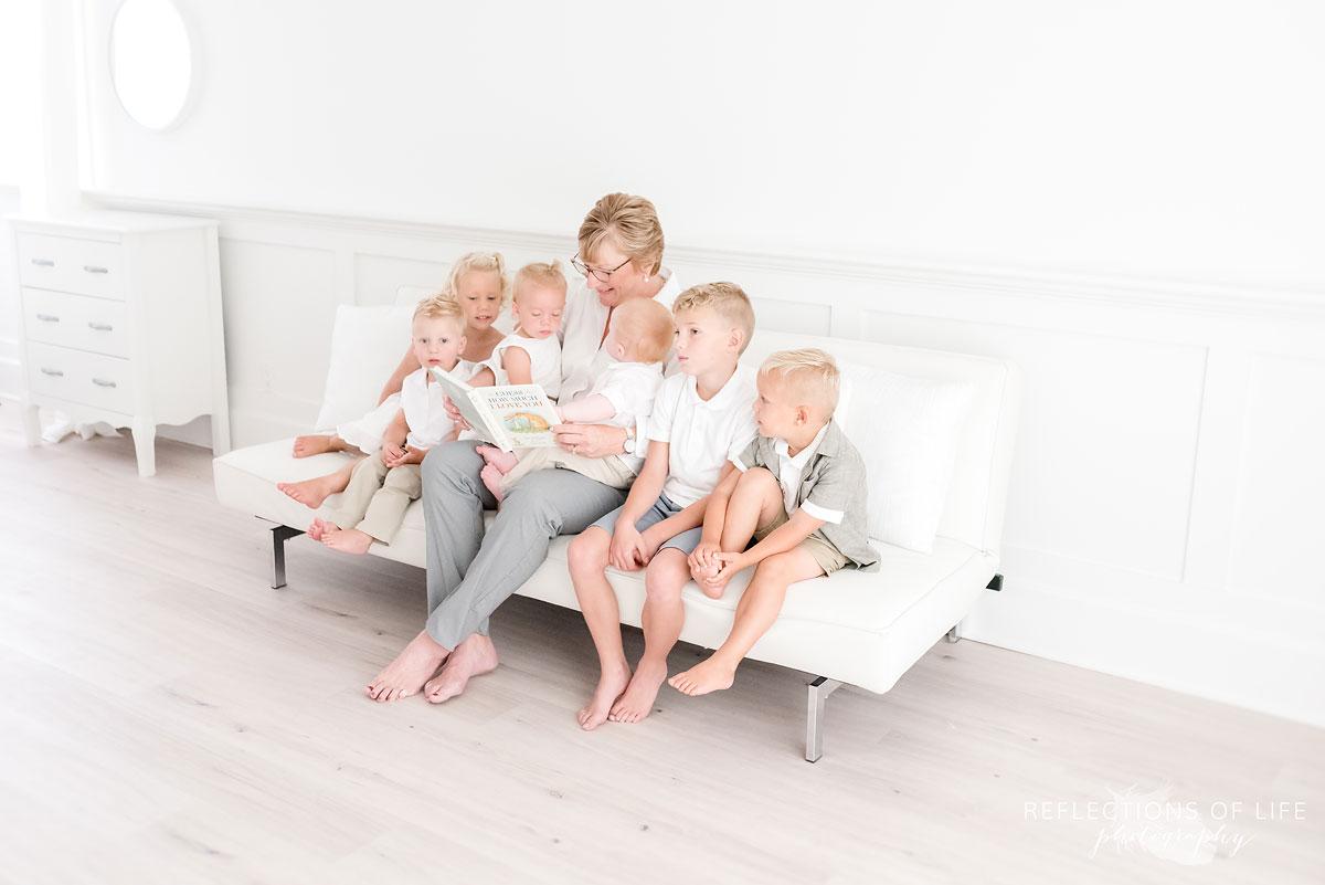 Grandma reading to her grandkids in natural light studio in Grimsby Ontario