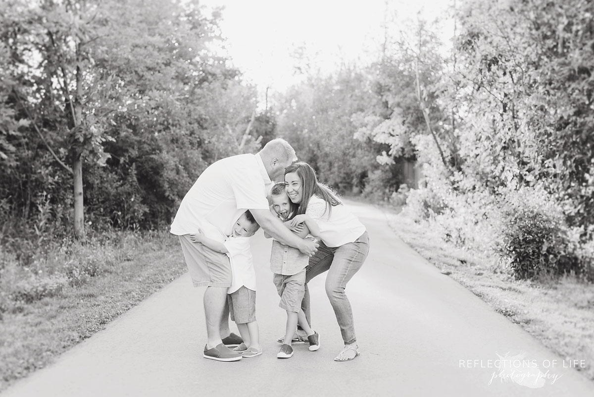 family hugging in black and white