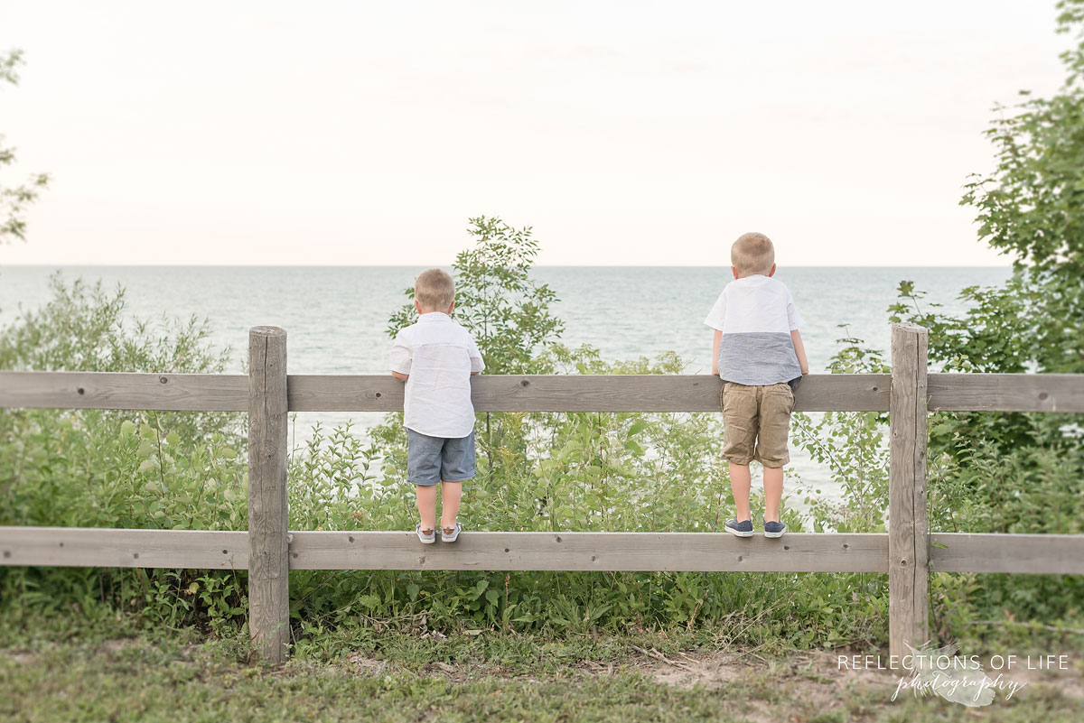 Little boys looking over the fence at Casablanca Beach in Grimsby