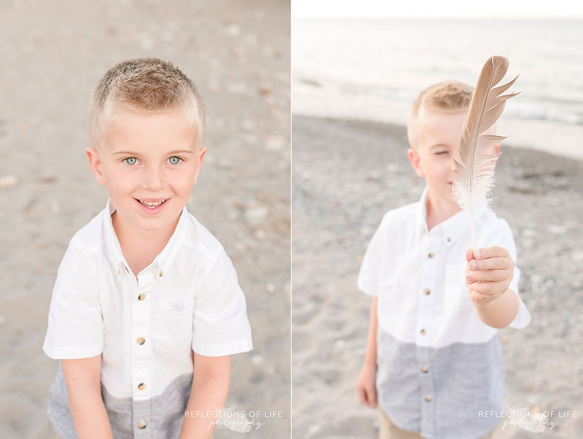 Boy playing with feather at Grimsby beach in Ontario