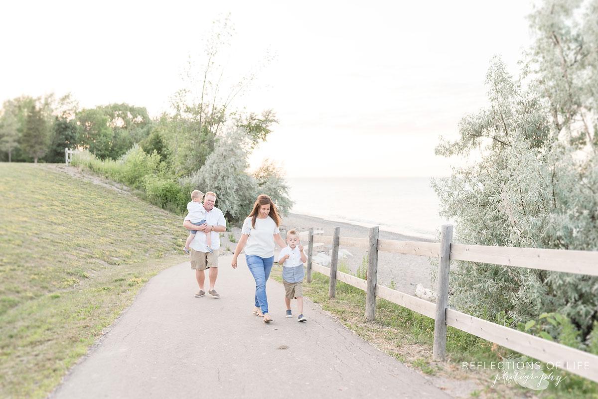 Family walks down the path at Casablanca Beach in Grimsby Ontario