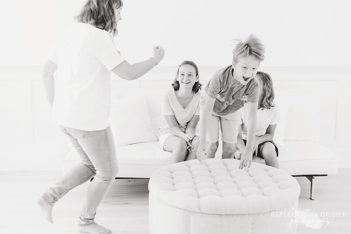 Action photography of kids playing with their mama.jpg