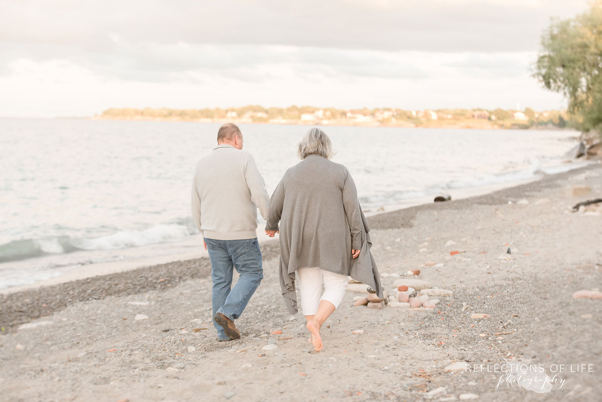 Husband and wife walking along Casablanca Beach in grimsby ontario