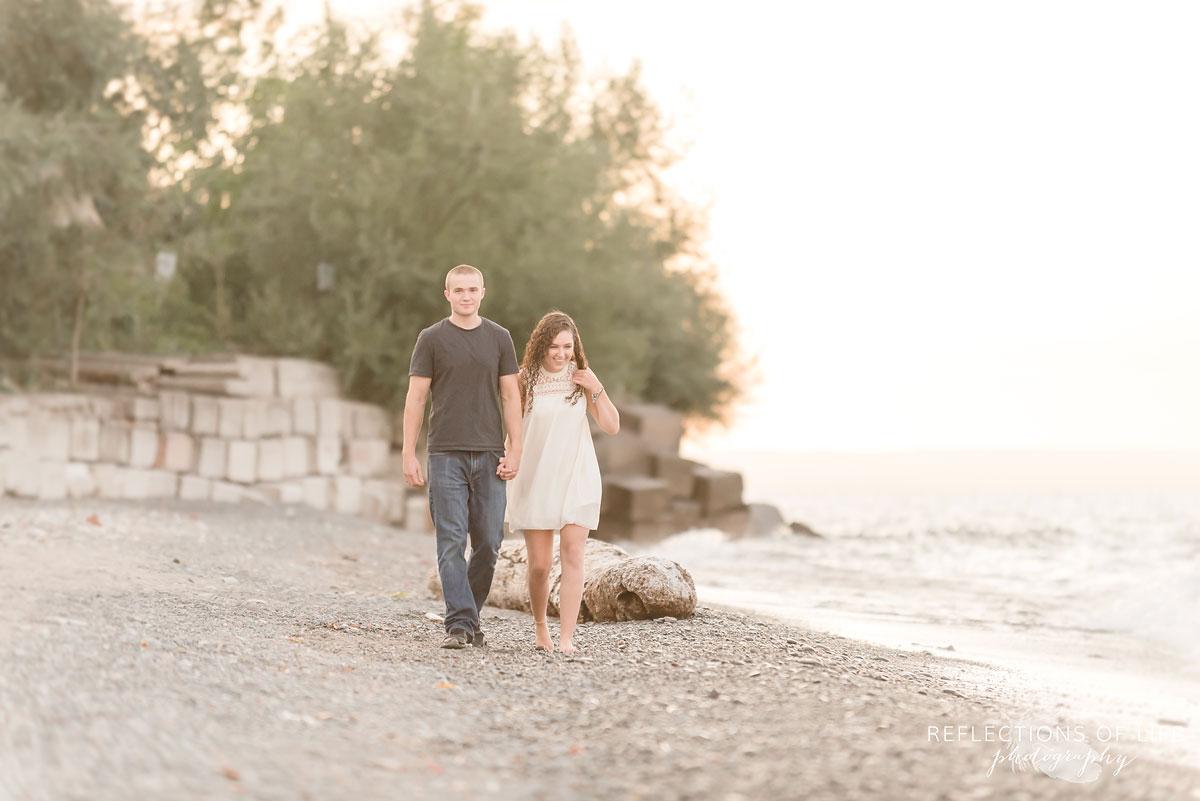 Girl and boy walking on the beach in Niagara Region