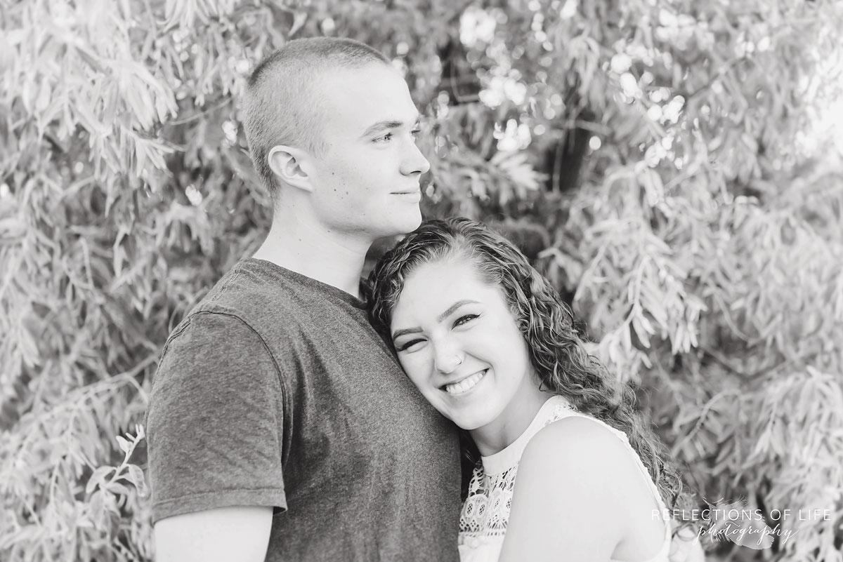 Girlfriend and boyfriend hugging on the beach