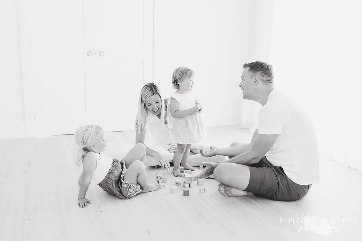 black and white of family in white studio