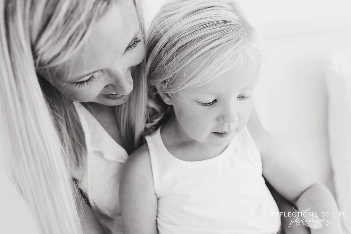 black and white of mom and daughter looking down