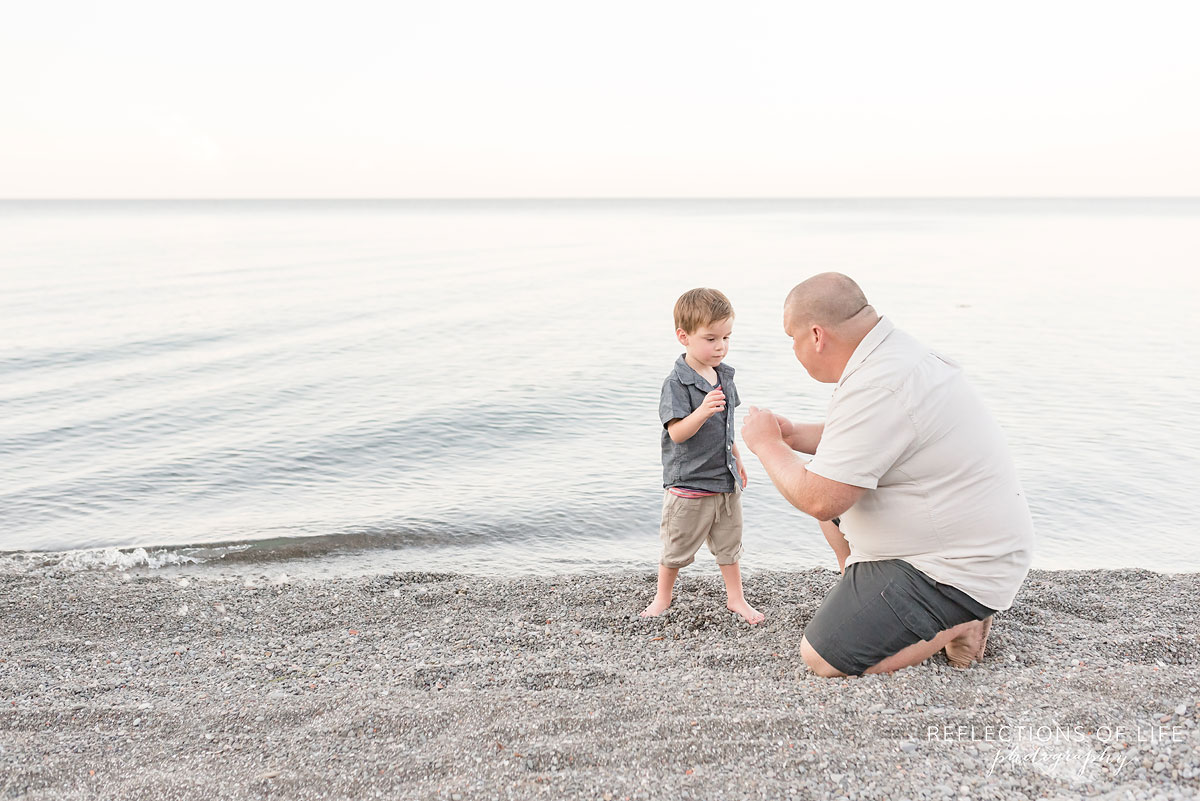 Father and son looking at each other in Grimsby Ontario