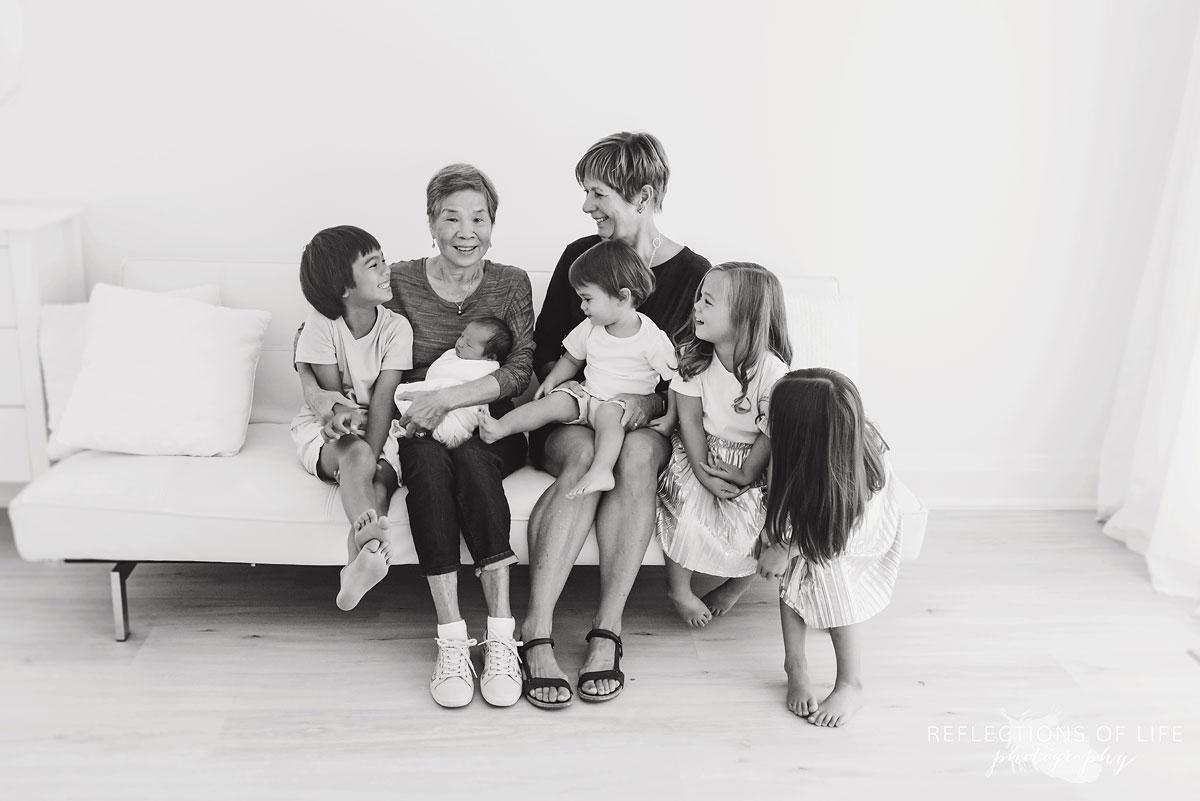 five grandchildren looking at grandmas black and white