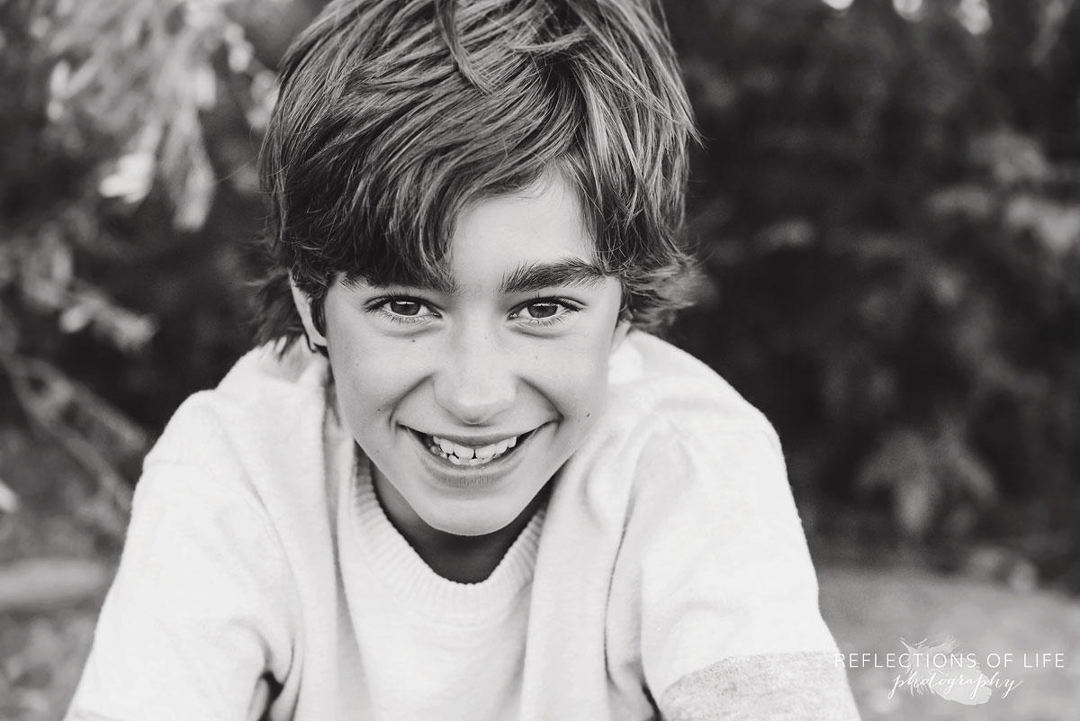 young boy smiling at family photographer Karen Byker