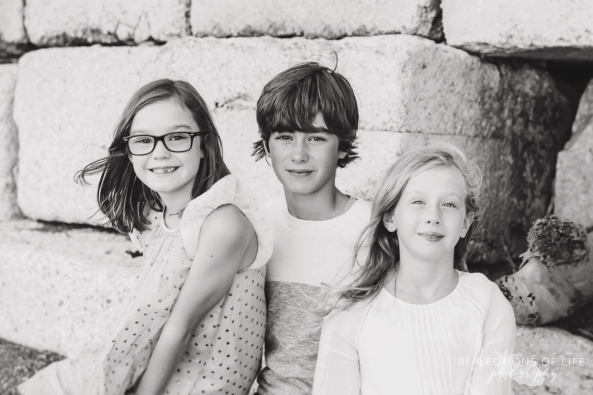 black and white of brother and two sisters
