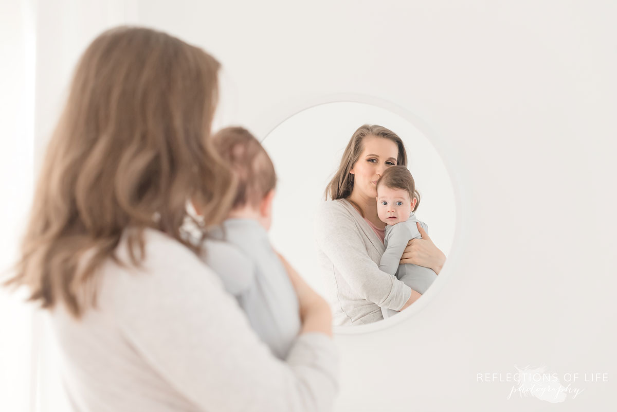 mother and baby looking in mirror