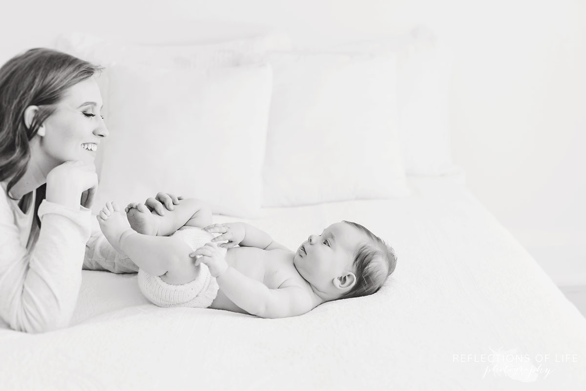 mother smiling at baby in niagara