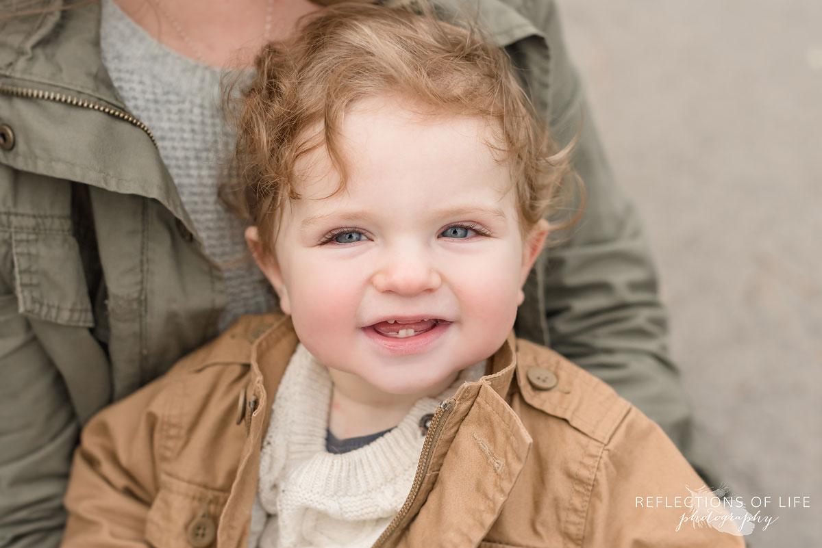 portrait of toddler smiling at camera