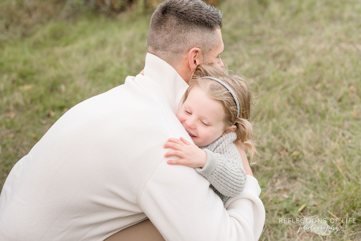 father and daughter hugging in niagara region
