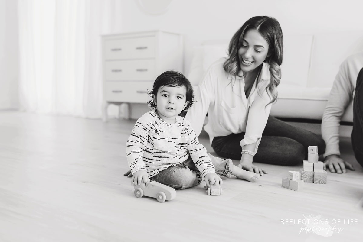 mother and child in studio black and white