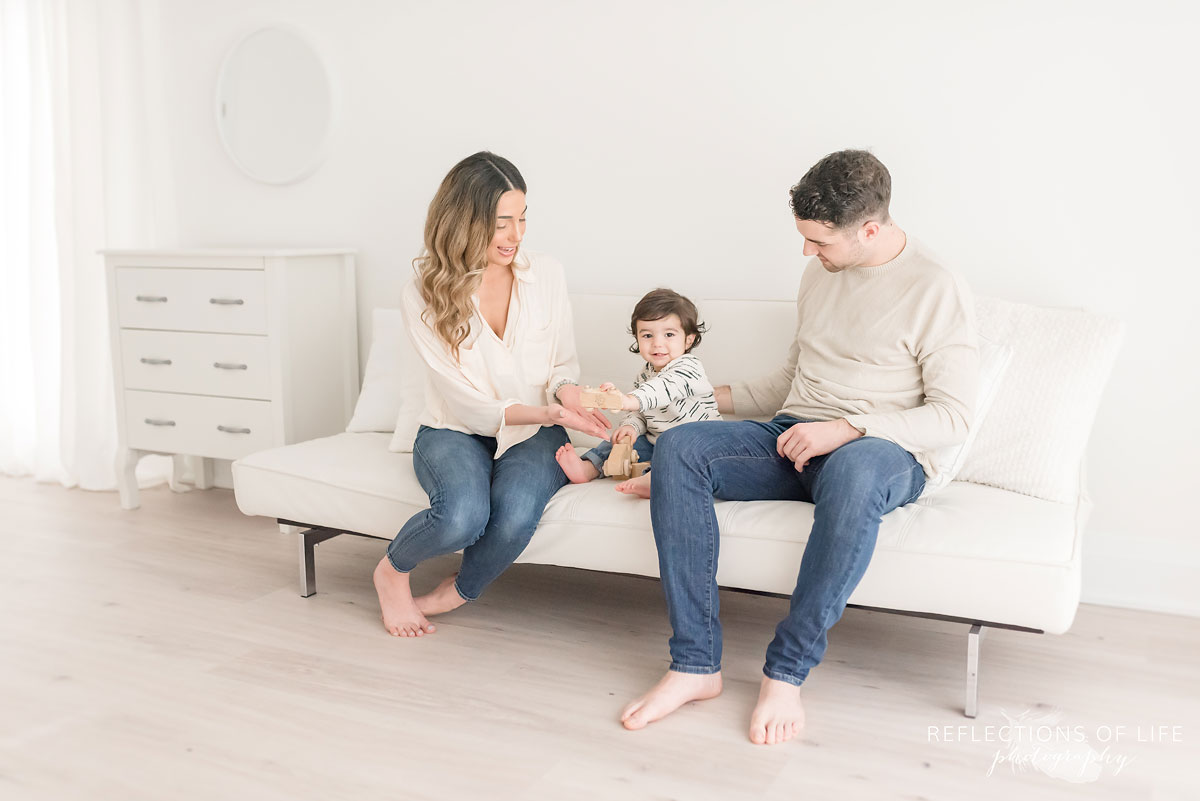 family on white couch