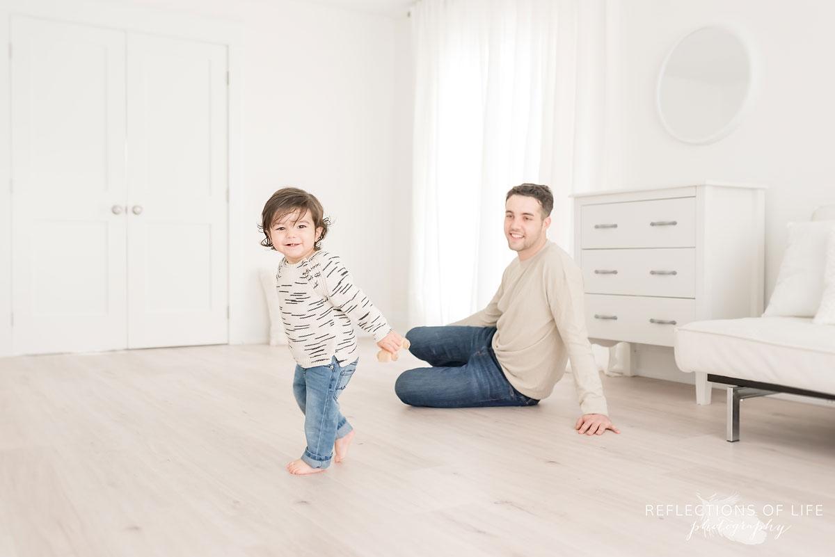 toddler running around studio