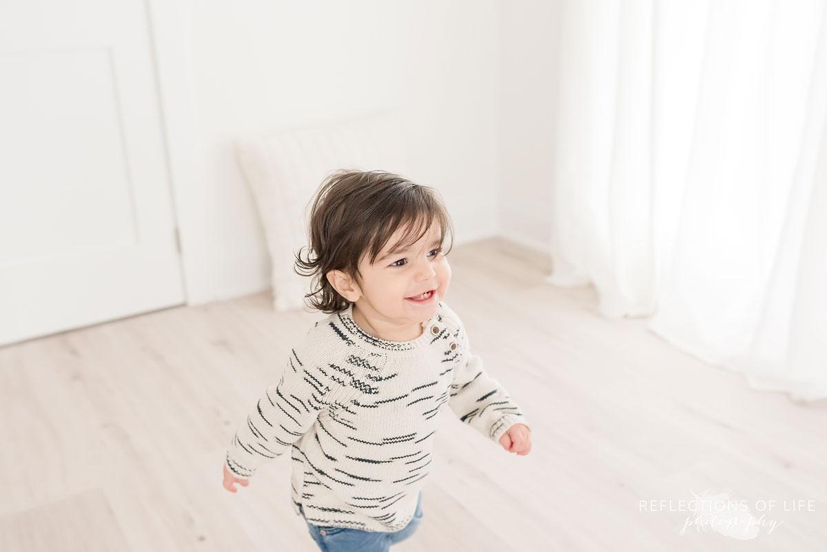 little one runing around studio niagara region