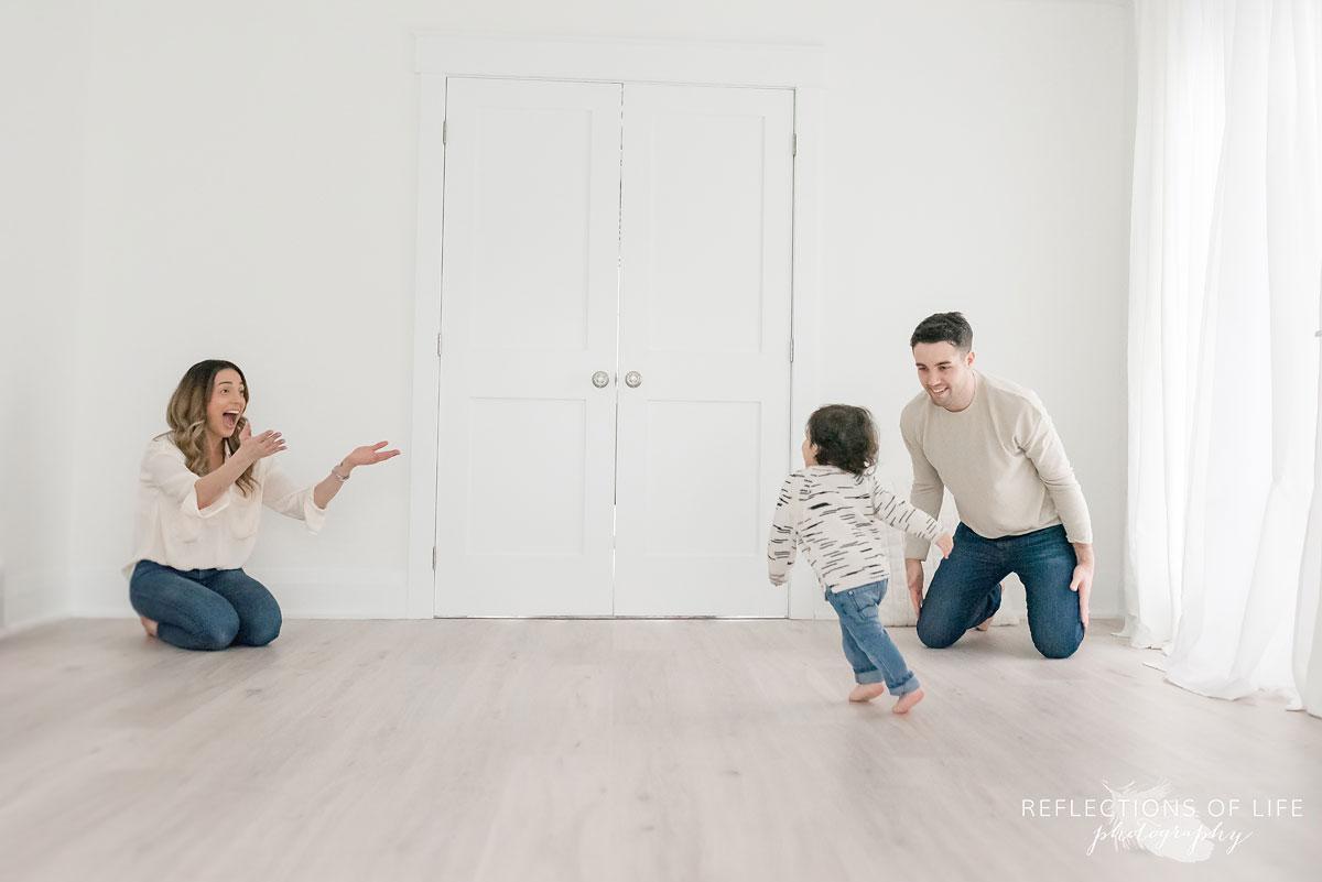 little boy running to parents