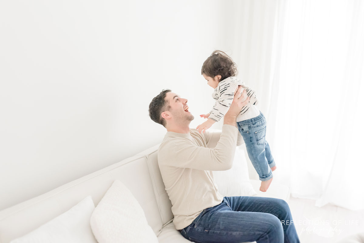 father holding child