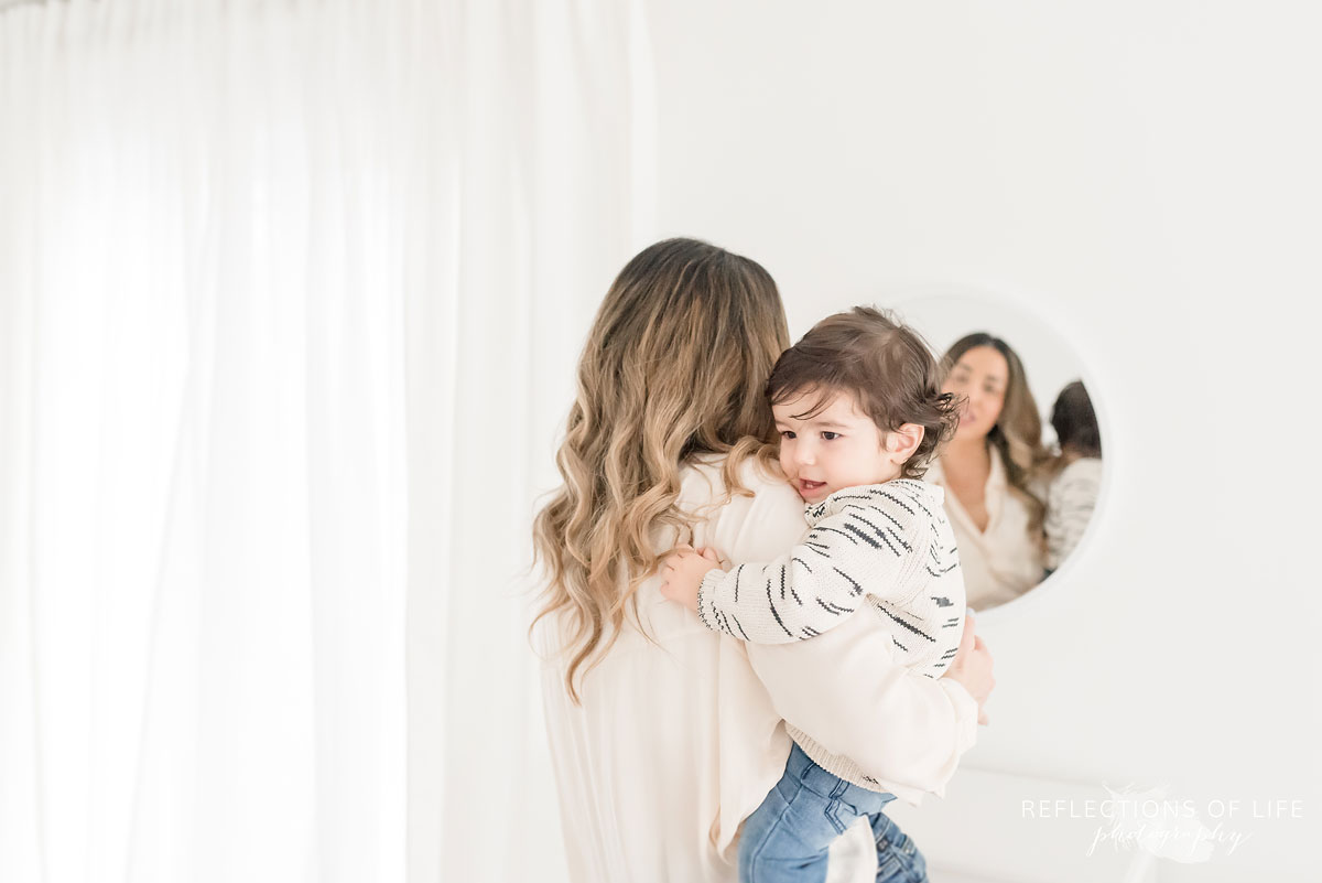 mother and child in mirror