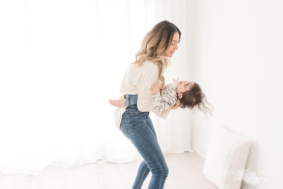 mother swinging child around