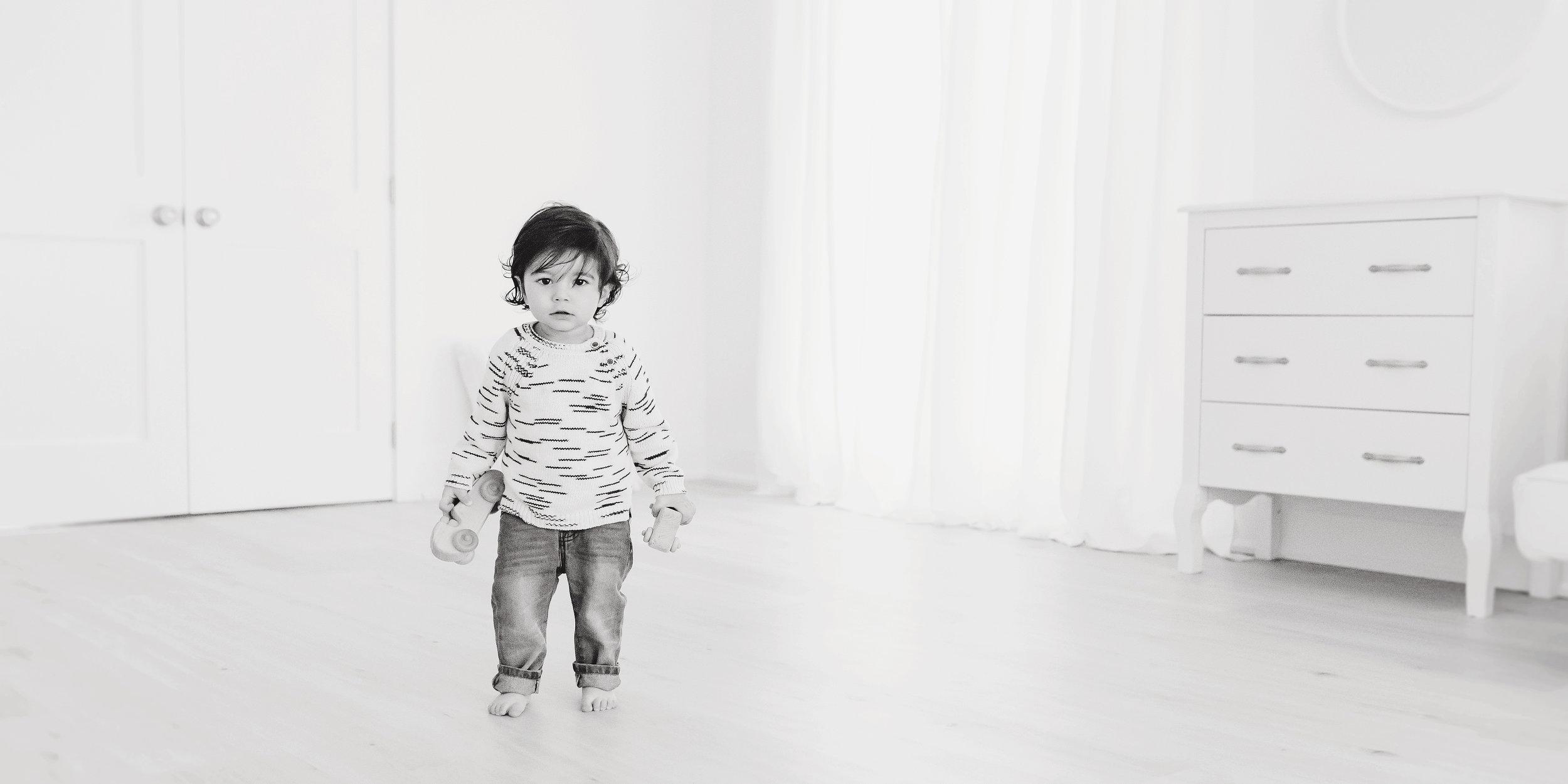 little boy black and white studio
