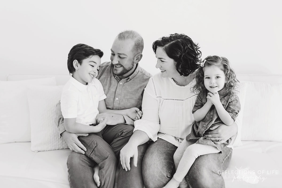 Familiy on white couch