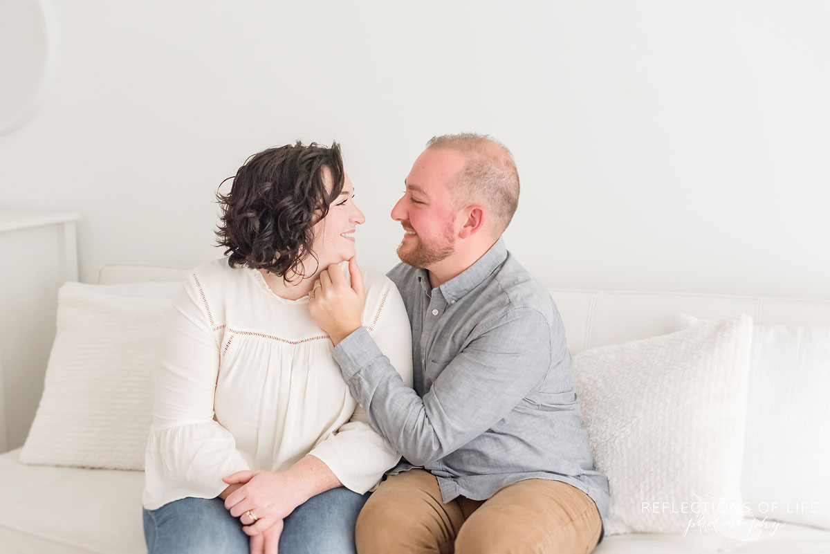 husband holding wifes face
