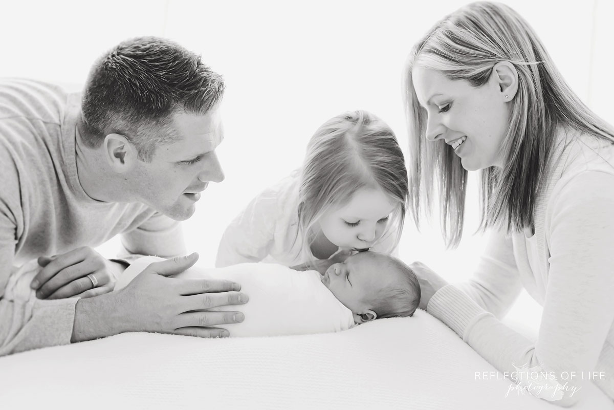 family+looking+at+newborn.jpg