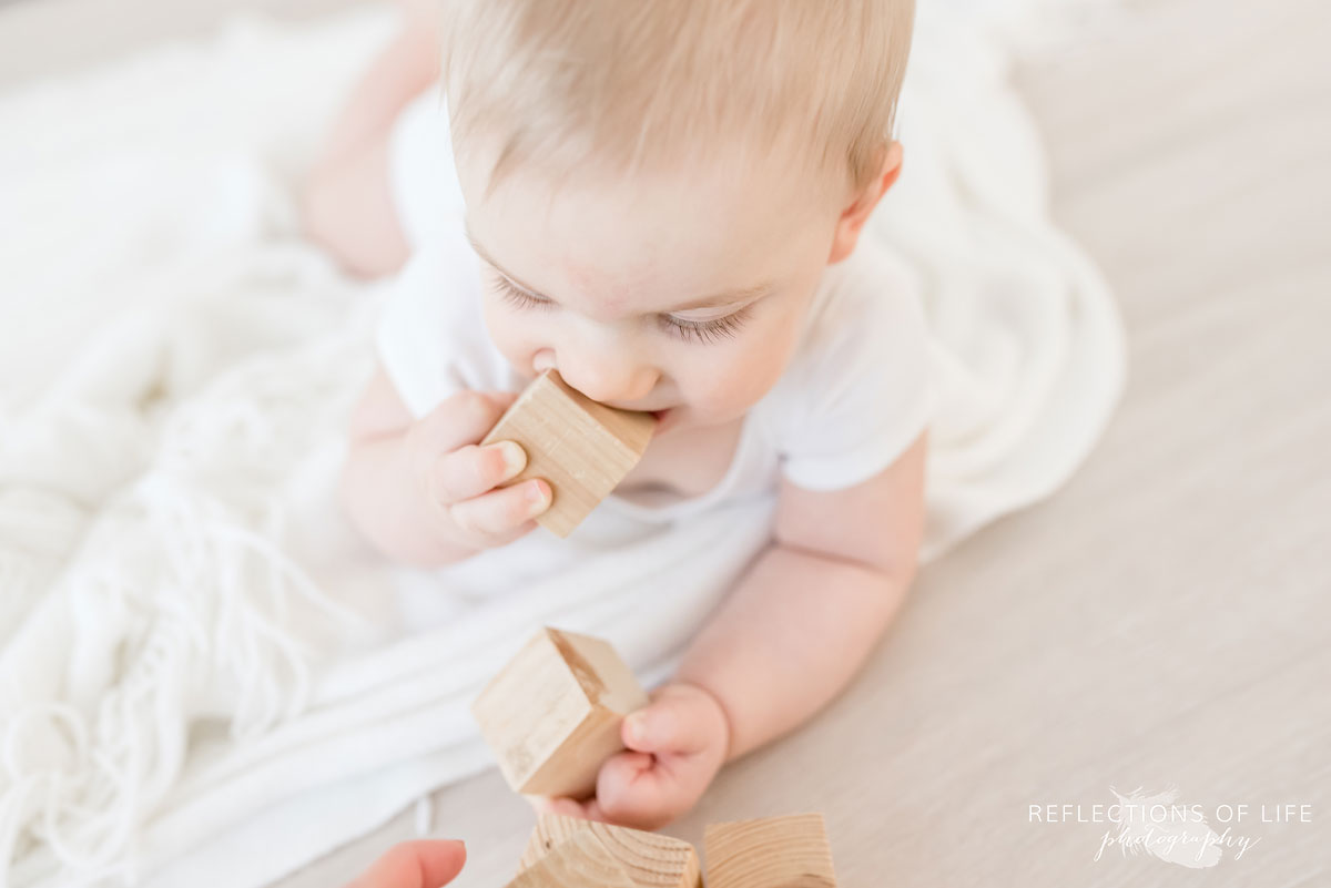 Copy of Copy of Baby boy eating wood blocks in natural light Grimsby Ontario studio