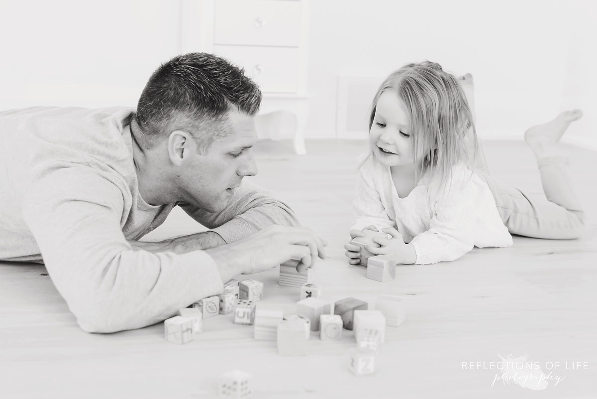 father and daughter playing in studio.jpg